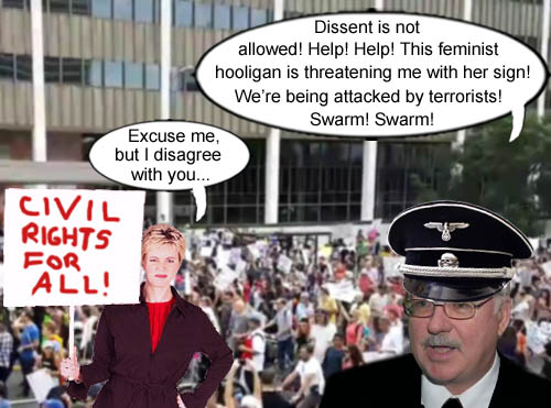 Arizona state senator, John Kavanagh, does his best Gestapo officer impersonation as a peaceful protester has the audacity to practice her right to lawful assembly as guaranteed by the U.S. Constitution.